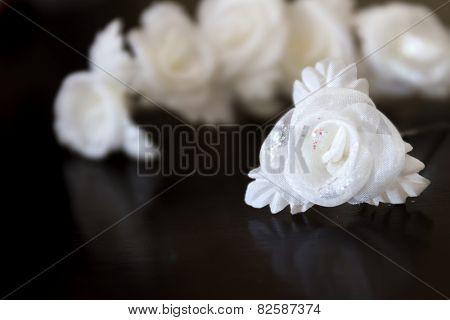 white wedding hair decoration isolated over black, horizontal orientation, nobody