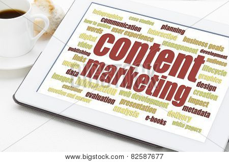 content marketing word cloud on a digital tablet with a cup of coffee