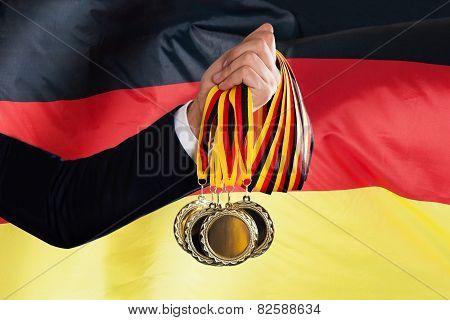 Businessman Holding German Medals