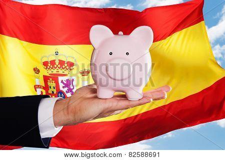 Spanish Businessman Holding Piggybank