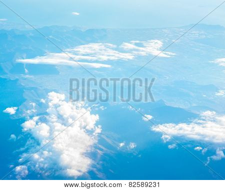 flying above the clouds in the sky