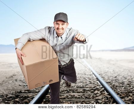 smiling delivery man and desert background