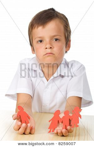 Sad Kid With Paper People In Hands - Divorce Concept