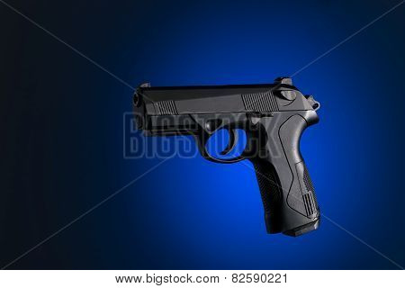 Handgun With Blue And Black Background