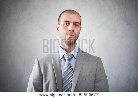 Serious businessman on a grungy background