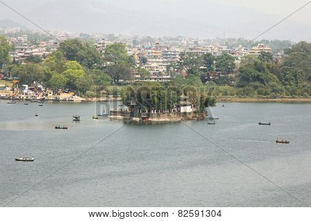 POKHARA, NEPAL - APRIL 2014 : The Taal Barahi Temple on an island in Phewa Lake on 15 April 2014 in Pokhara, Nepal. Phewa Tal Lake or Fewa Lake is a freshwater lake in the south of the Pokhara Valley