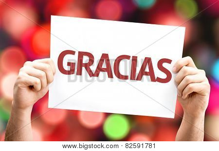 Thank You (in Spanish) card with colorful background with defocused lights