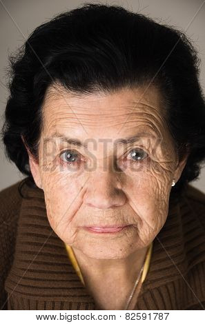 portrait of grandmother looking nostalgic at camera