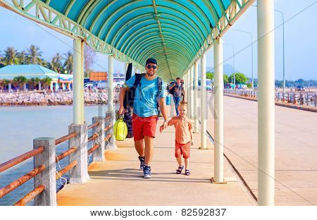 Happy Father And Son Are Going To Board A Ship At The Pier Station
