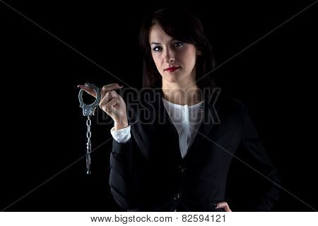 Image serious woman with pair of handcuffs