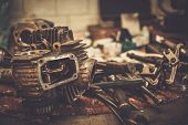 stock photo of motorcycle  - Part of motorcycle engine on a table in workshop - JPG