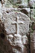 Embossed christian cross on stone