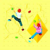 image of climbing wall  - Boy and girl climbing a rock wall - JPG