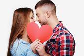stock photo of kiss  - Caucasian couple having romantic time together - JPG