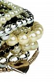 image of gem  - Stack of Various Pearl Silver and Black Jewelry Gems Bracelets with Silver Heart Shape closeup - JPG