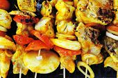 foto of kababs  - fresh raw roast shish kebab on barbecue grill grid coocked over hot charcoal - JPG