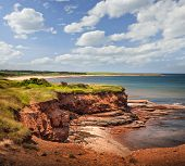 foto of cliffs  - Red cliffs of Prince Edward Island Atlantic coast at East Point - JPG