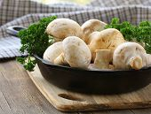 foto of champignons  - fresh raw mushrooms champignons with herbs parsley - JPG