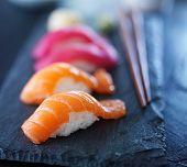 stock photo of slating  - salmon and tuna sushi on slate - JPG