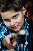 picture of cello  - young boy Cellist pointing with cello fiddlesticks - JPG