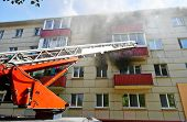pic of firemen  - fireman climbing a ladder with water hose for extinguish fire - JPG