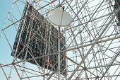 picture of scaffolding  - Part of the construction scaffold with satellite antenna - JPG