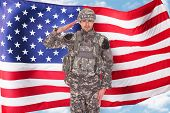 foto of salute  - Portrait Of American Soldier Saluting In Front Of Flag - JPG