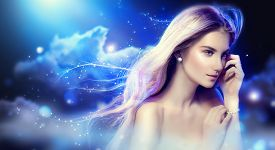 image of hair blowing  - Beauty fantasy girl with long blowing hair over night sky with stars - JPG
