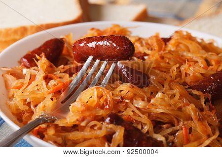 Sauerkraut With Sausage Macro In A White Plate. Horizontal
