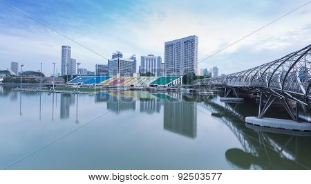 Tourist walking on the Marina Bay Sands with water reflection