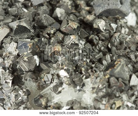 Closeup macro picture of black lead ore irregular texture