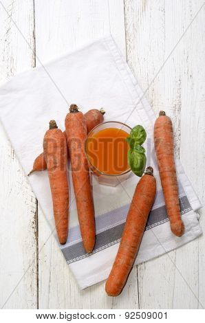 Carrot Smoothie With Basil On A Kitchen Towel