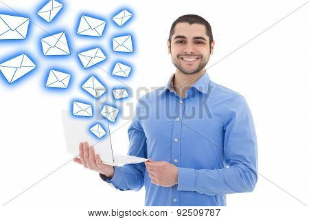 Spam Concept - Portrait Of Handsome Arabic Man Sending Messages With Laptop Isolated On White