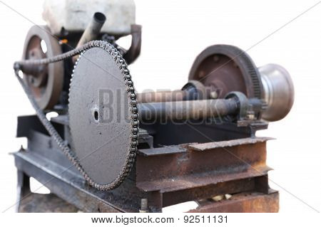 Old And Rusty Engin With Chain