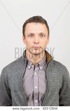 Young Serious Caucasian Man In Casual Clothing