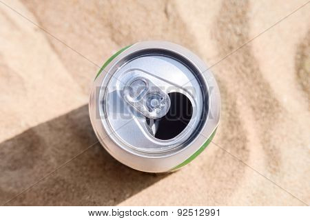 Aluminum Can Of Beer Stands On Beach Sand