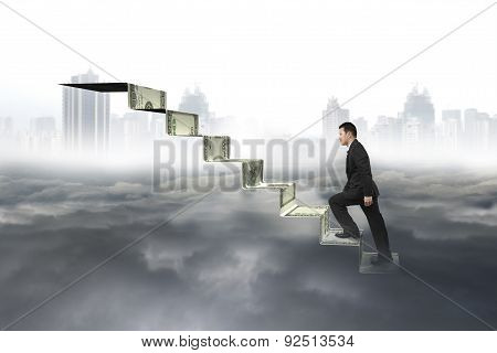 Man Climbing On Money Stairs With Cityscape Cloudscape