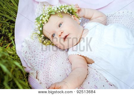 baby and flower lily of the valley