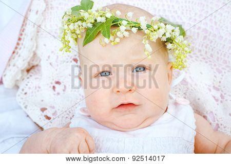 Newborns in a wreath