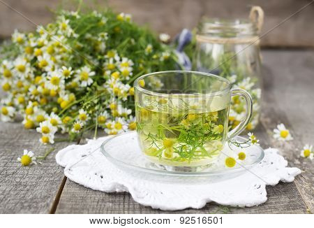 Chamomile Tea In A Glass Cup On A Wooden Background