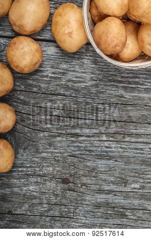 New Potatoes In A Basket On A Vintage Wooden Background