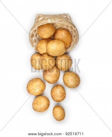 New Potatoes In An Overturned Basket On An Isolated Background