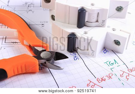 Metal Pliers And Electric Fuse On Construction Drawing