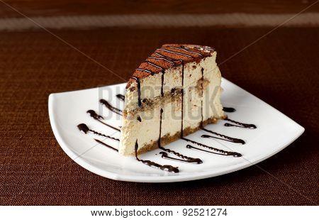 Tiramisu Cake On A White Plate