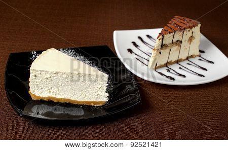 Tiramisu And Cheesecake On A Dark Background