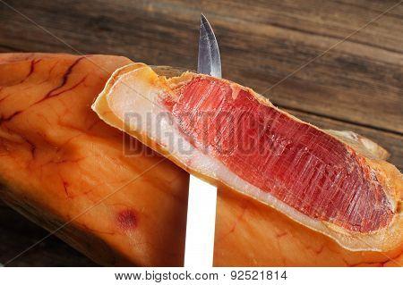 Parma ham (jamon) sliced on wooden board