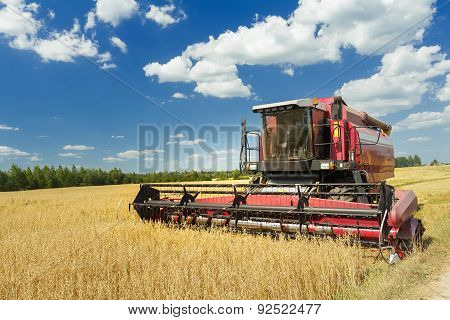 Combine Machine With Air-conditioned Cab Harvesting Oats On Farm Field