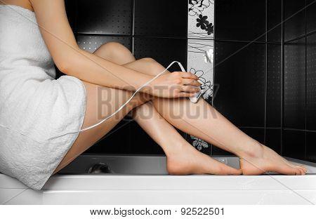 Woman legs. Epilator.