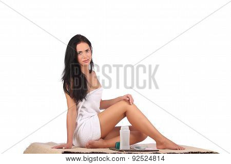 Beautiful Female Body Legs With Cosmetic Container Bowl And Cream
