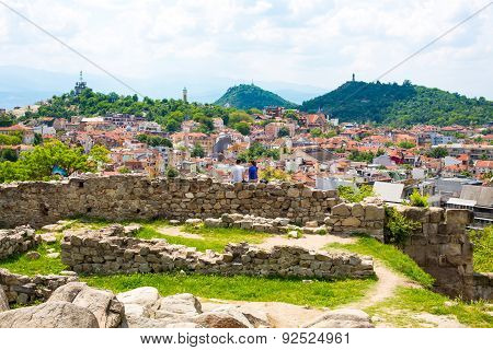 Couple Sitting At Fortress Wall And Looking The View Of Plovdiv City, Bulgaria